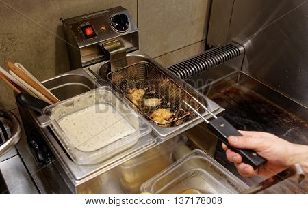 Chef is making nuggets, cheap fast food restaurant