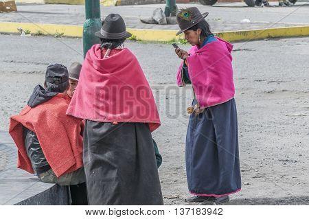 ALAUSI, ECUADOR, OCTOBER - 2015 - Group of native ecuadorian indigenous women dressing traditional clothes in Alausi Ecuador