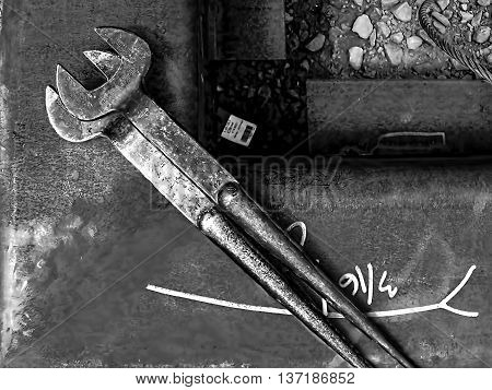 Two wrenches on Steel tube with markings
