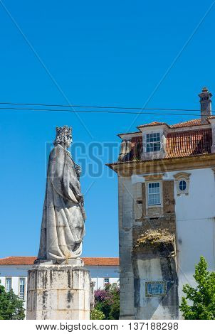 Denis of Portugal called the Farmer King Dom Dinis statue in Praca Dom Dinis Square in University of Coimbra. Portugal.