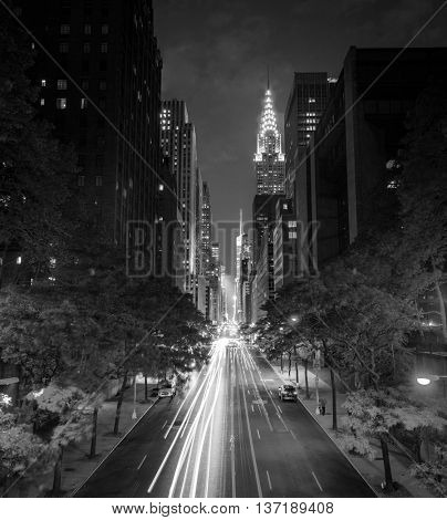 New York's famous 42nd Street at night long exposure with Times Square in the distance in black and white