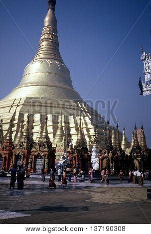 RANGOON / MYANMAR - CIRCA 1987: Buddhists worship at the magnificent Shwedagon Pagoda in Rangoon.
