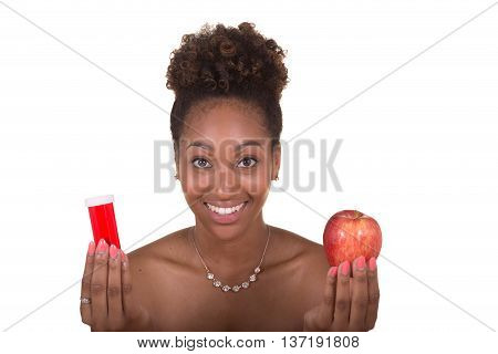 Concept shot of  a young woman choosing between pills and an apple