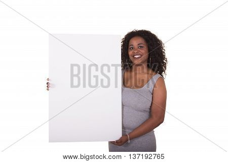 Young woman holding a poster board isolated on white