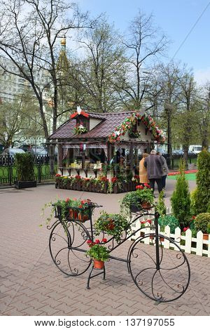 MOSCOW - MAY 02, 2015: Forged Decorative bicycle with flower pots at Sokolniki area on Moscow Spring Festival