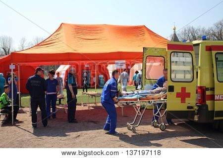 MOSCOW - APR 28, 2015: Victim assistance on the sorting site in the field hospital. Taktiko-specific exercises in the stadium Burevestnik