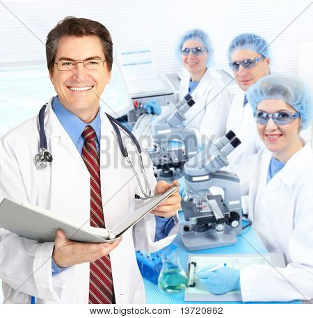 Science team working with microscopes in a laboratory poster