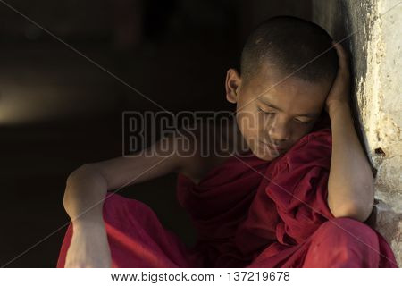 Burmese novice Sitting sleep in Buddhist temple