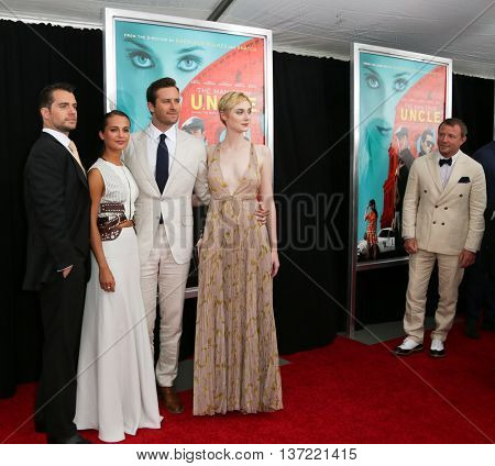 (L-R) Actors Henry Cavill, Alicia Vikander, Armie Hammer, Elizabeth Debicki and director Guy Ritchie attend