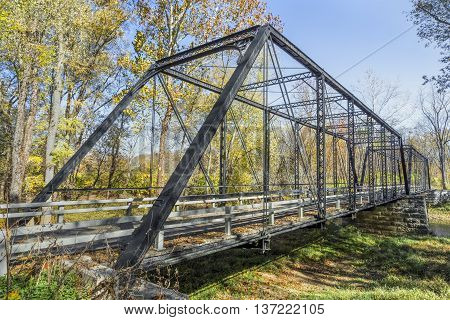 Built in 1885 the Furnas Mill Bridge a two span pinned Pratt through truss of wrought iron and steel crosses Sugar Creek in Johnson County Indiana.