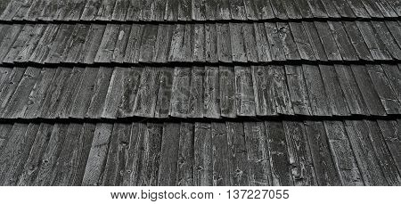 wooden planks on the roof of a wooden house