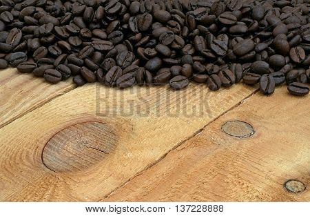 black coffee hill on bright wooden boards