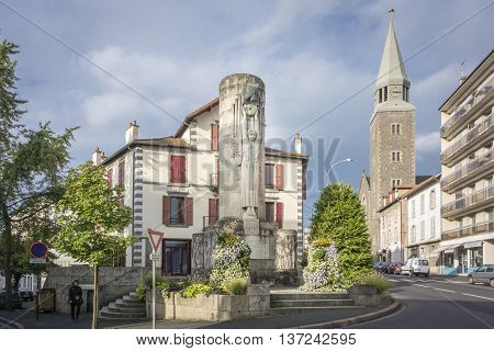 AURILLAC, FRANCE, 12 SEPTEMBER 2013 - Monument of Paul Doumer and the Sacre Coeur church in Aurillac France