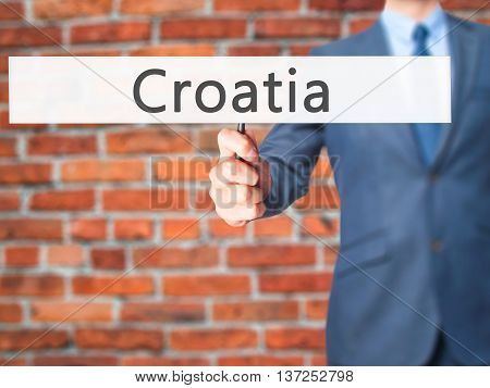 Croatia - Businessman Hand Holding Sign