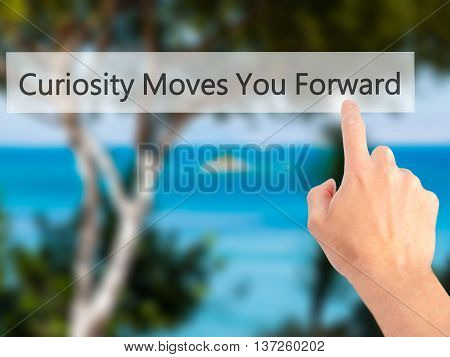 Curiosity Moves You Forward - Hand Pressing A Button On Blurred Background Concept On Visual Screen.