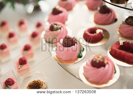 Delicious wedding reception candy bar dessert table.