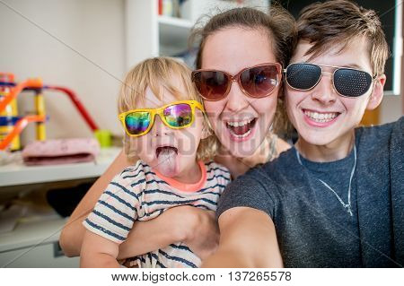 Cheerful family posing together for photo selfie
