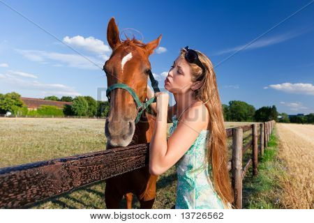 poster of horse and blond girl in paddock on summers day