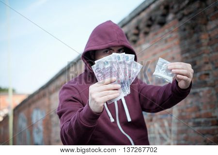 Pusher selling and trafficking drug dose for money cash