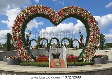 MOSCOW, RUSSIA - JUNE 23, 2016: Bridge to bench reconciliation in the center of the arch of flowers bridge of love landmark