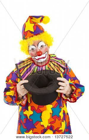 Sad birthday clown lost his bunny in the magic top hat.  Isolated.