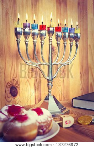 Jewish Holiday Hanukkah With Menorah, Torah, Donuts And Wooden Dreidels