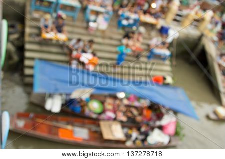 The Blurr the Amphawa floating market.in Thailand.