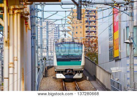 TOKYO JAPAN - NOVEMBER 29 2015: A local train arrives at Ikebukuro station
