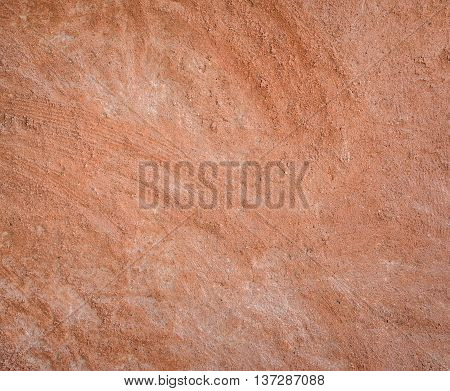 Red natural wall texture of cob house for background. It is a natural building material made from subsoil water and straw fibrous organic material.