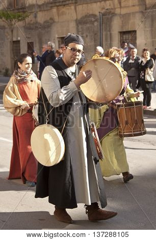 Enna, Italy - May 2016: Tambourine man takes part in the medieval costume parade along the street. Tenth Edition of Historical Parade, 15 may 2016, Enna, Sicily