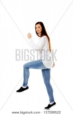 Young woman trying to trample something