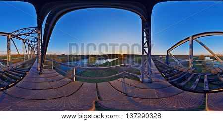 360 panorama of a disused railway bridge across the Mures river at sunset