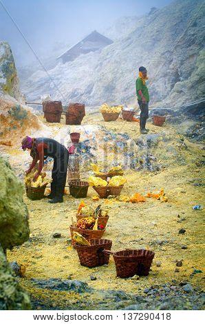 Workers Extracting Sulfur Inside Crater In Ijen Volcano,  Indone