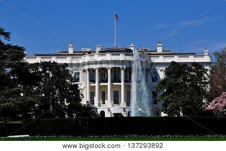 Washington DC - April 10 2014: The south front of the White House with gardens and fountain *