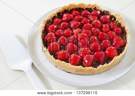 A decadent chocolate strawberry tart.
