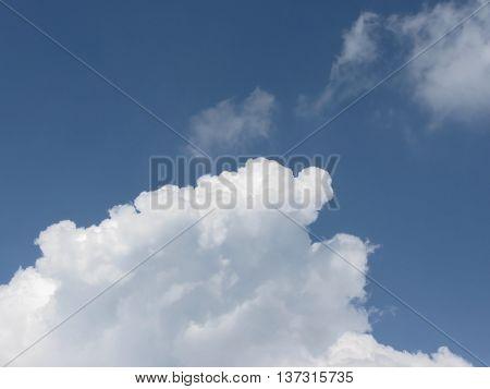 Sky with giants cumulonimbus clouds and sun rays through