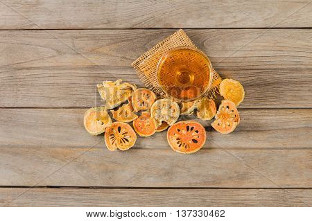 water quince with quince on wooden table