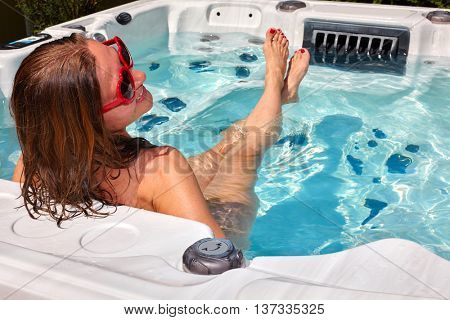 Beautiful woman relaxing in hot tub.