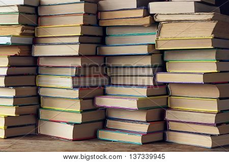 Background from books. The piles of books on the shelf closeup. Library. Back to school.