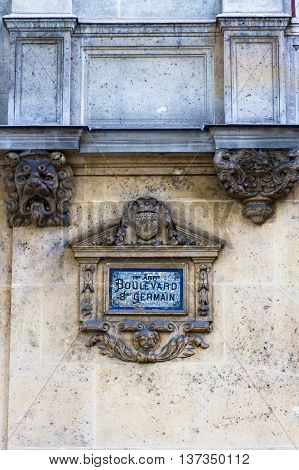 Sign for Boulevard Snt Germain in blue mosaic. Road sign on wall Paris France.