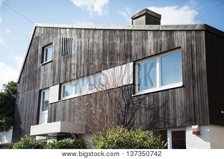 House with wood paneling and alarm in Germany