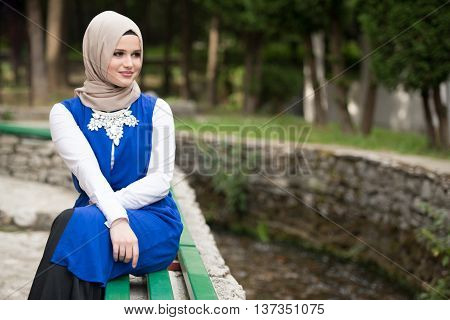Young Muslim Woman In Head Scarf