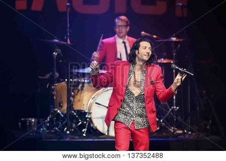 HUNTINGTON, NY-MAR 7: Singer Nasri (foreground) of the reggae fusion band Magic! performs in concert at The Paramount on March 7, 2015 in Huntington, New York.