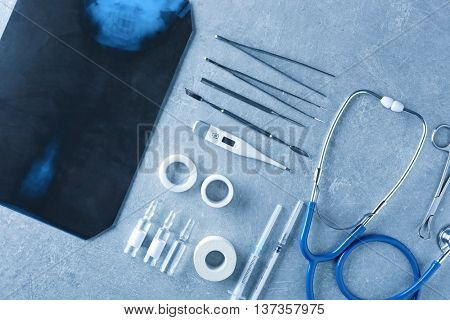 Medical tools set with x-ray on gray background