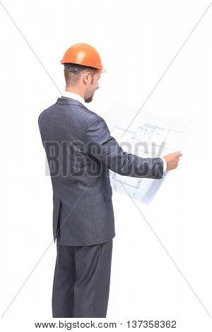 Confident engeneer in formalwear and hardhat examining blueprint isolated on white baskground