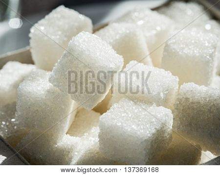 Close up shot of white refinery sugar.