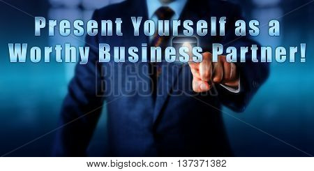 Entrepreneur is pressing Present Yourself as a Worthy Business Partner! on an interactive touch screen. Business objective concept motivational metaphor call to action and career advice.