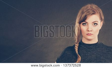 Bad and negative emotions and feelings concept. Blonde unhappy sad woman. Depressed dissatisfied young girl portrait. Facial emotions.