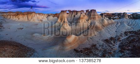 Sunset at Bisti Badlands in De-Na-Zin Wilderness, New Mexico, USA. This is a rolling landscape of badlands which offers some of the most unusual scenery found in the Four Corners Region.