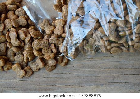 dog food pour from plastic bag on wooden board